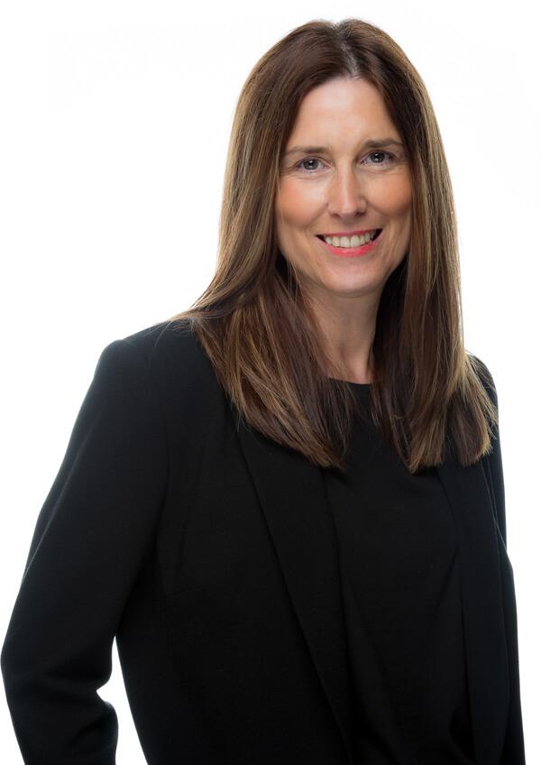 A picture of Andrea Trafford on a corporate attire