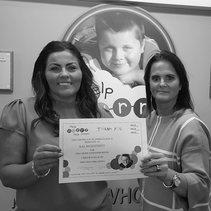 Two ladies holding KAG Certificate