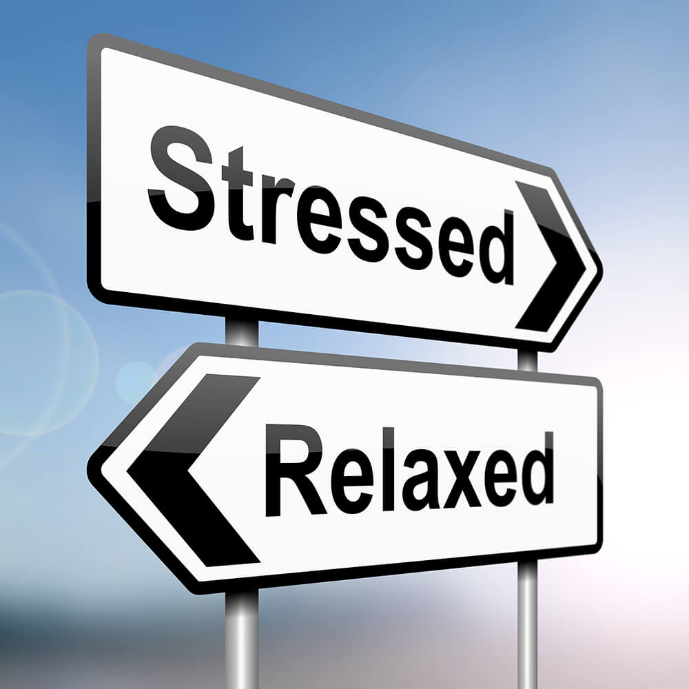 "2 sign board that says ""stressed"" and ""relaxed"""
